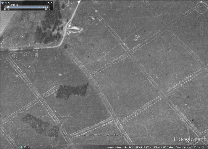 Anti-glider trenches at Sutton Hoo with the excavated ship-burial at the top of the picture. Source: Google Earth.